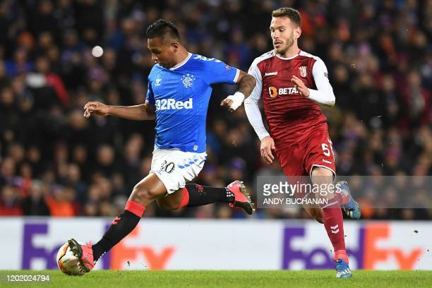 Rangers' Colombian striker Alfredo Morelos runs past Sporting Braga's Portuguese defender Nuno Sequeira during the UEFA Europa League round of 32...