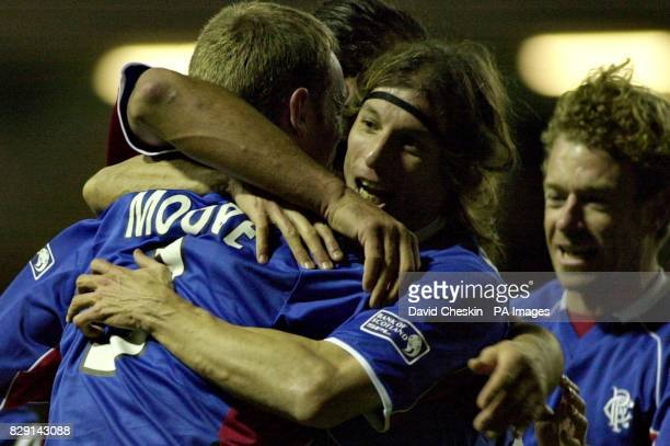 Ranger`s Craig Moore celebrates his first goal against Hibernian with Claudio Caniggia as Bert Konterman runs in from the right during their Scottish...