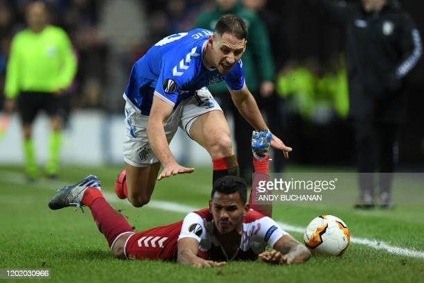 Rangers' Croatian defender Nikola Katic clashes with Sporting Braga's Brazilian midfielder Wenderson Galeno during the UEFA Europa League round of 32...