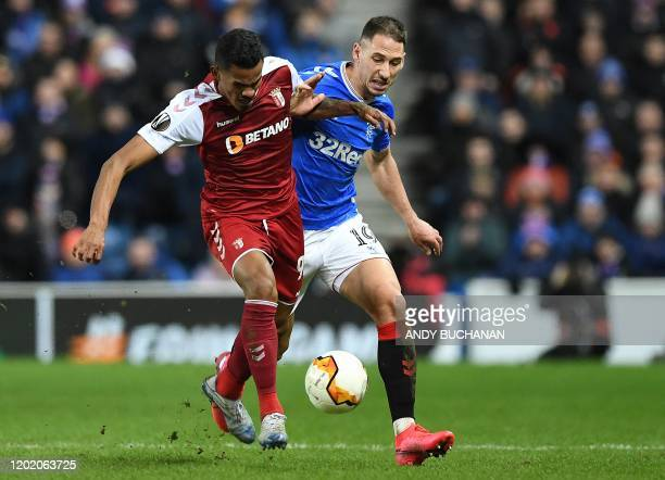 Rangers' Croatian defender Nikola Katic vies with Sporting Braga's Brazilian midfielder Wenderson Galeno during the UEFA Europa League round of 32...