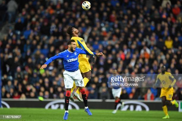 Rangers' English defender Connor Goldson vies with Porto's Cape Verde striker Ze Luis during the UEFA Europa League Group G football match between...