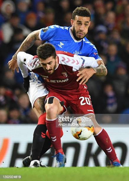 Rangers' English defender Connor Goldson vies with Sporting Braga's Portuguese striker Paulinho during the UEFA Europa League round of 32 first leg...