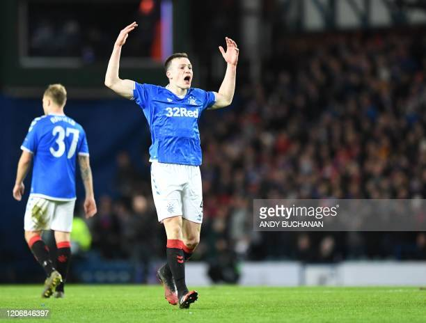 Rangers' English defender George Edmundson celebrates scoring his team's first goal during the UEFA Europa League round of 16 first leg football...