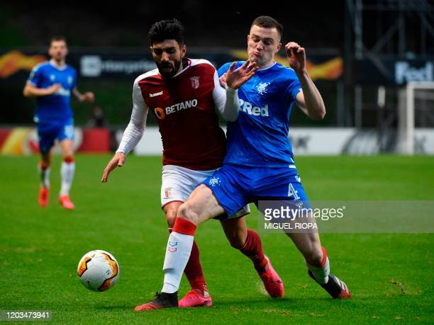Rangers' English defender George Edmundson vies with Sporting Braga's Portuguese defender Ricardo Esgaio during the UEFA Europa League round of 32...