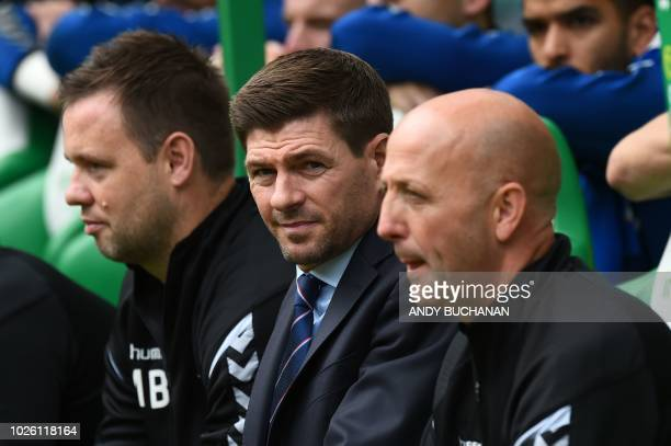 Ranger's English manager Steven Gerrard looks on before the start of the Scottish Premiership football match between Celtic and Rangers at Celtic...