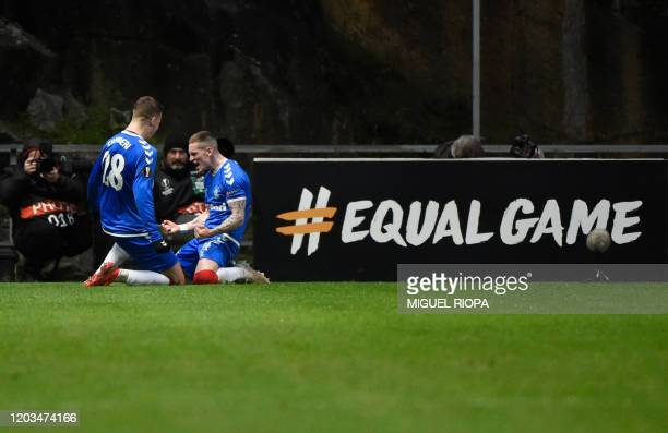 Rangers' English midfielder Ryan Kent celebrates after scoring a goal during the UEFA Europa League round of 32 second leg football match between SC...