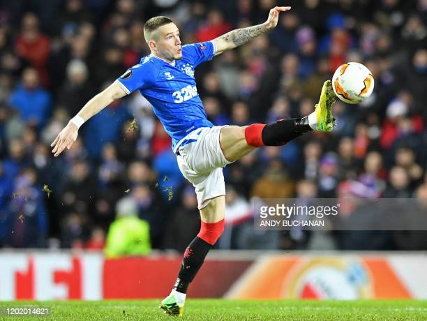 Rangers' English midfielder Ryan Kent controls the ball during the UEFA Europa League round of 32 first leg football match between Rangers and...
