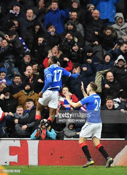 Rangers' English striker Joseph AyodeleAribo celebrates scoring his team's second goal during the UEFA Europa League round of 32 first leg football...
