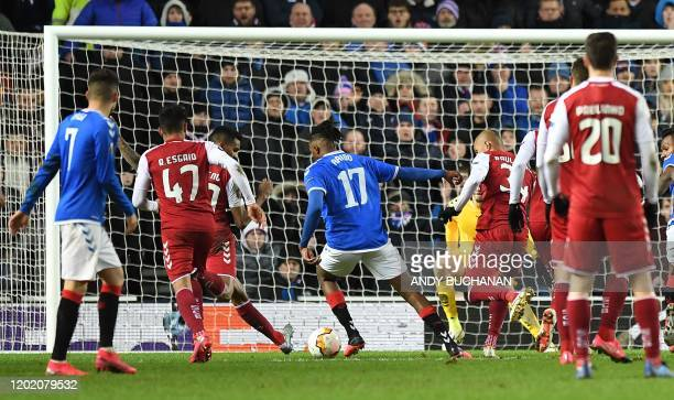 Rangers' English striker Joseph AyodeleAribo runs to score his team's second goal during the UEFA Europa League round of 32 first leg football match...
