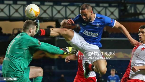 Rangers' English striker Kemar Roofe is sent off for this challenge on Slavia Prague's Czech goalkeeper Ondrej Kolar during the UEFA Europa League...