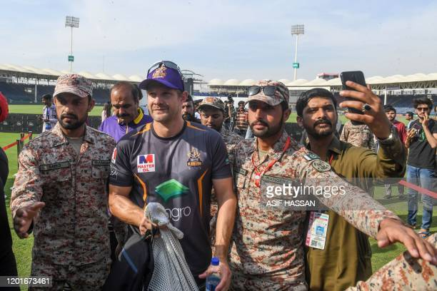 TOPSHOT Rangers escort Quetta Gladiators' Shane Watson of Australia as he leaves the ground after a practice session for the upcoming 2020 Pakistan...