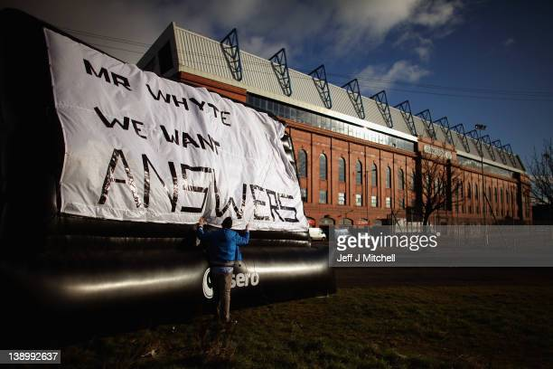 Rangers fan Michael Haggerty displays a banner outside directed to club owner Craig Whyte outside the Ibrox Stadium on February 15 2012 in Glasgow...