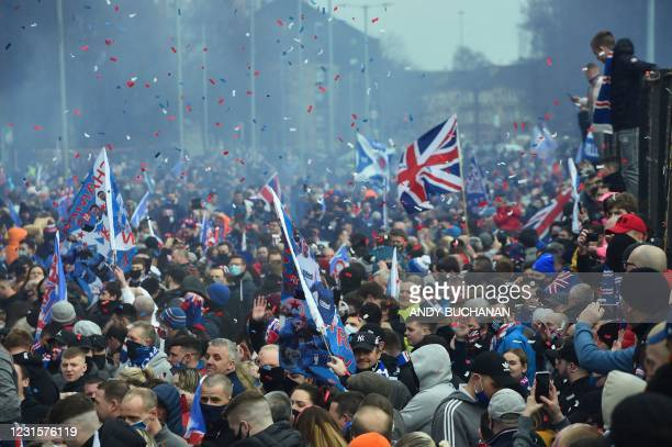 Rangers fans celebrate outside Ibrox Stadium, home of Rangers Football Club, in Glasgow on March 7, 2021 after their first Scottish Premiership title...