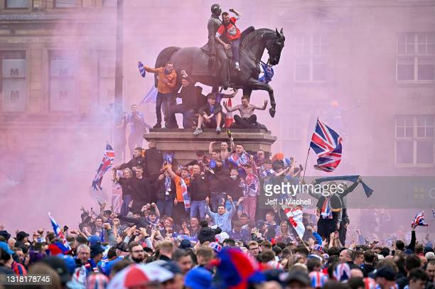 Rangers fans celebrate winning the Scottish Premiership title at George Square on May 15, 2021 in Glasgow, Scotland. Rangers have won their first...