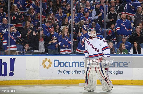 Rangers fans cheers as Mackenzie Skapski of the New York Rangers tends goal against the Buffalo Sabres on February 20 2015 at the First Niagara...