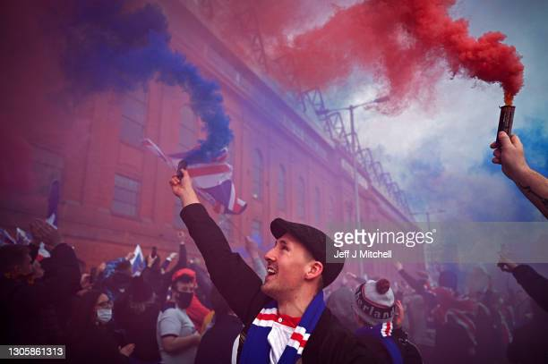 Rangers fans gather at Ibrox stadium to celebrate the club winning the Scottish Premiership for the first time in 10 years, on March 07, 2021 in...