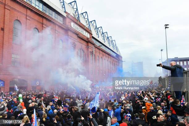 Rangers fans, gather outside the Ibrox Stadium, to celebrate their team winning the Scottish Premiership title on March 07, 2021 in Glasgow, Scotland.