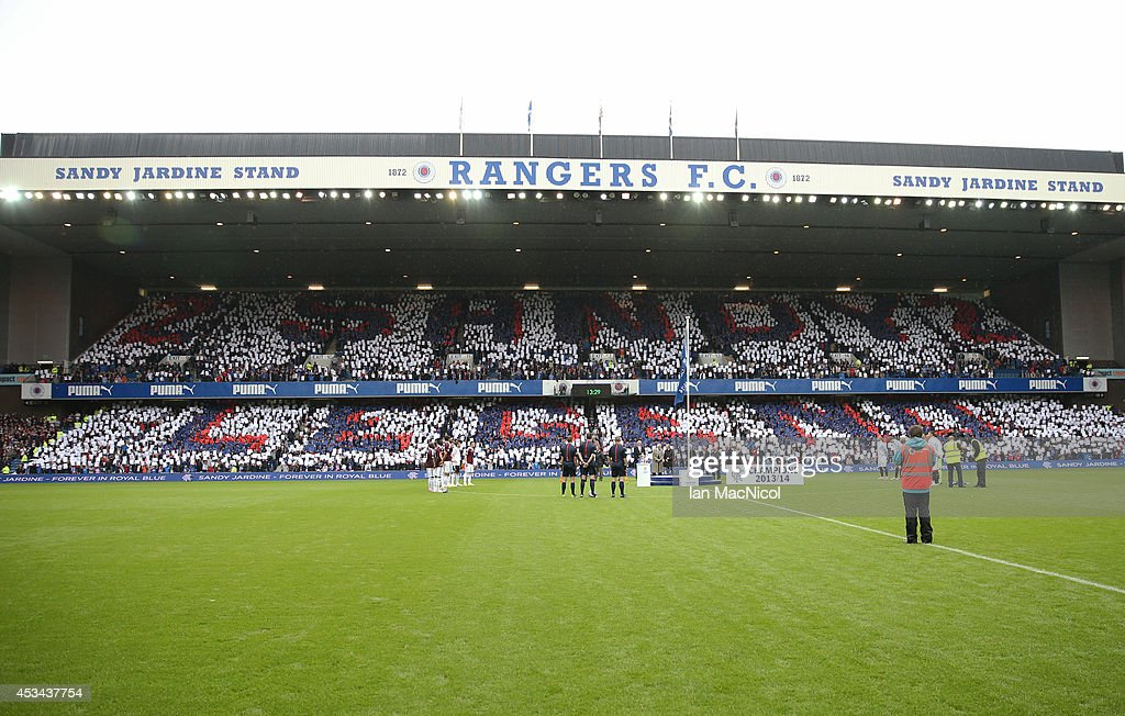 Rangers fans hold up cards to make a mosaic in the newly renamed Sandy Jardine stand during the Scottish Championship Opening League Match between Rangers and Hearts, at Ibrox Stadium on August 10, 2014 Glasgow, Scotland.