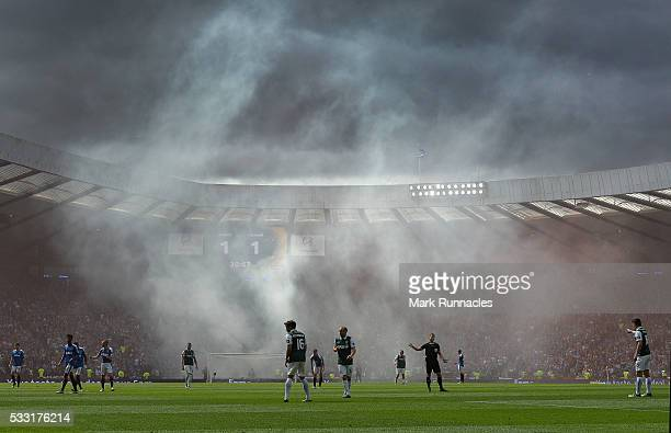 Rangers fans set off flares after Kenny Miller of Rangers scores their first goal in the first half during the William Hill Scottish Cup Final...