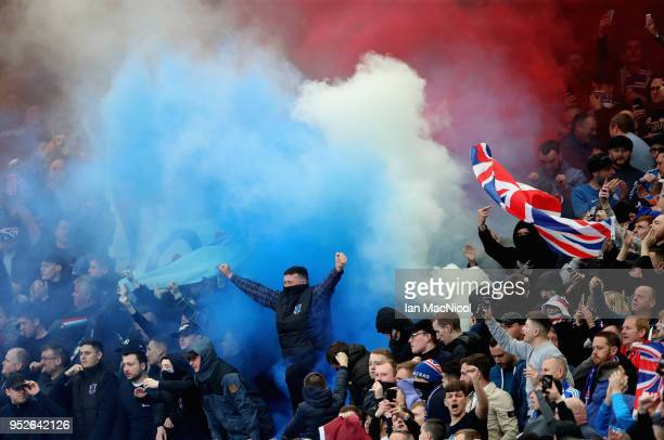 Rangers fans set off flares prior to the Scottish Premier League match between Celtic and Rangers at Celtic Park on April 29 2018 in Glasgow Scotland