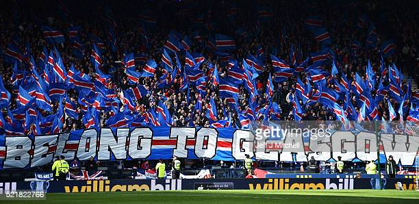 Rangers fans wave flags during the William Hill Scottish Cup semi final between Rangers and Celtic at Hampden Park on April 17, 2016 in Glasgow,...
