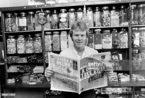 Rangers FC new signing Dave MacKinnon catches up on the Ibrox scene at his newsagents shop in Renfrew. Circa June 1982.