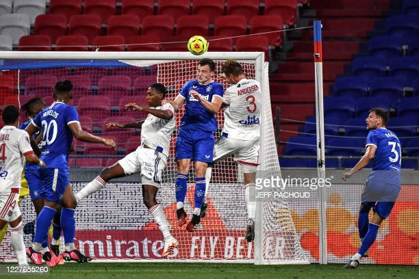 Rangers FC's English defender George Edmundson vies with Lyon's Danish defender Joachim Andersen and Lyon's Brazilian defender Marcelob during the...