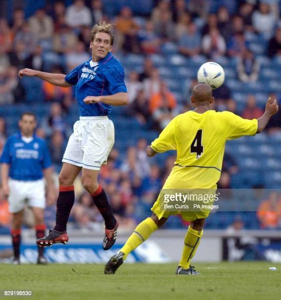 Rangers' Fernando Ricksen heads the ball past Leeds' Oliver Dacourt during the Rangers v Leeds United friendly match at Glasgow's Ibrox stadium THIS...