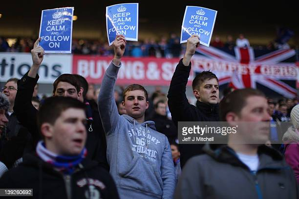 Rangers football fans show support for their club during the Clydesdale Bank, Scottish Premier League match between Rangers and Kilmarnock at Ibrox...