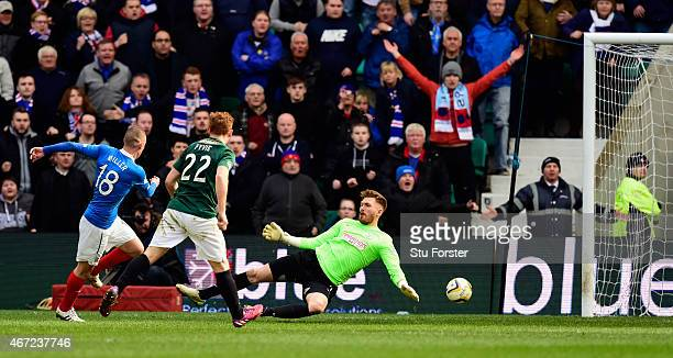 Rangers forward Kenny Miller slots the ball past Hibs goalkeeper Mark Oxley for the second goal during the Scottish Championship match between...