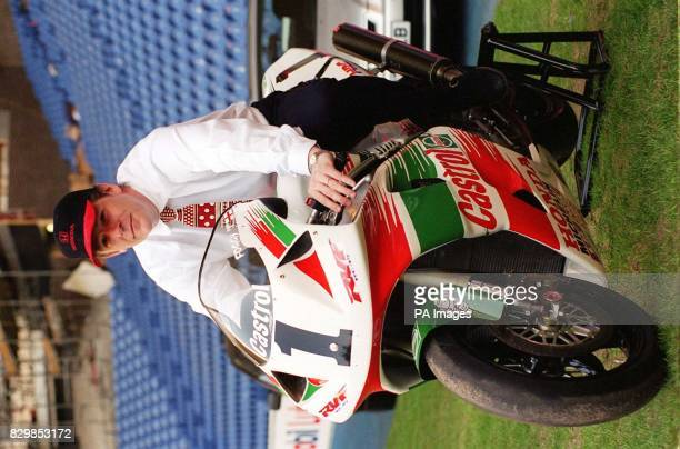 Rangers goalkeeper Andy Goram gets to grips with a Honda racing motorbike in Ibrox stadium during the club's open day prior to the Scotish Cup Final...