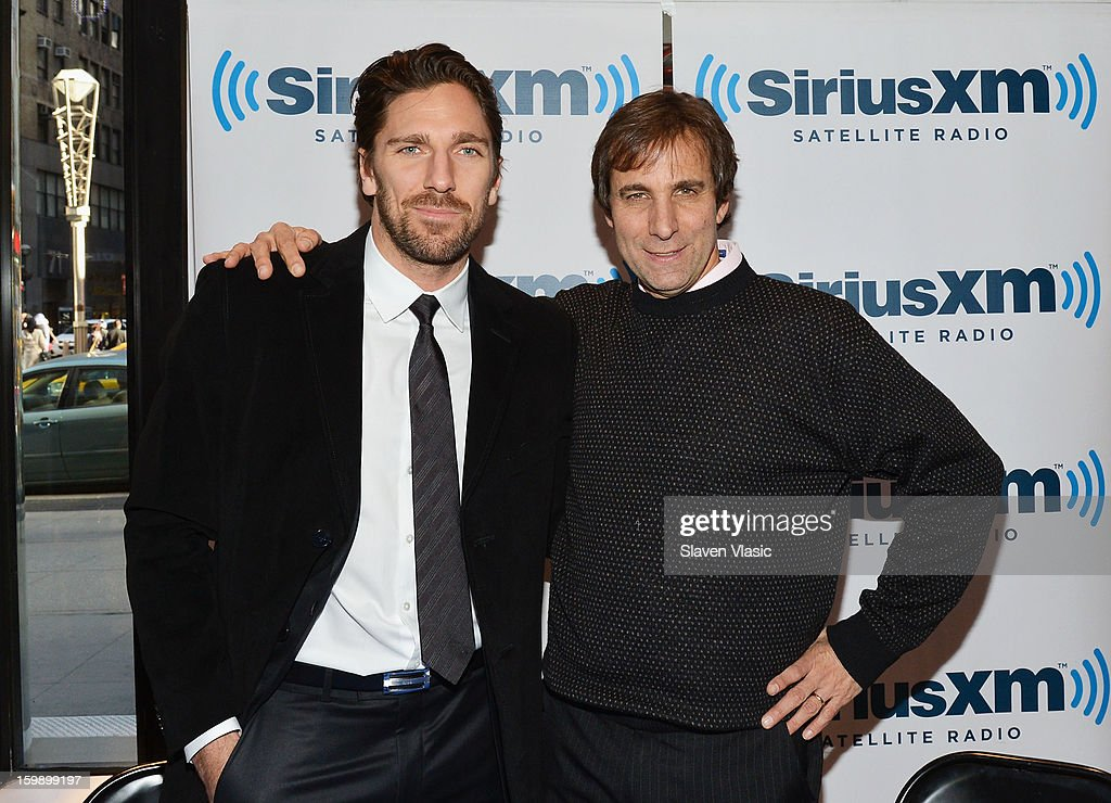 NY Rangers goaltender and reigning Vezina Trophy winner Henrik Lundqvist (L) poses with SiriusXM host Chris 'Mad Dog' Russo prior to an interview on SiriusXM's 'Mad Dog Unleashed' at the NHL Powered by Reebok Store on January 22, 2013 in New York City.