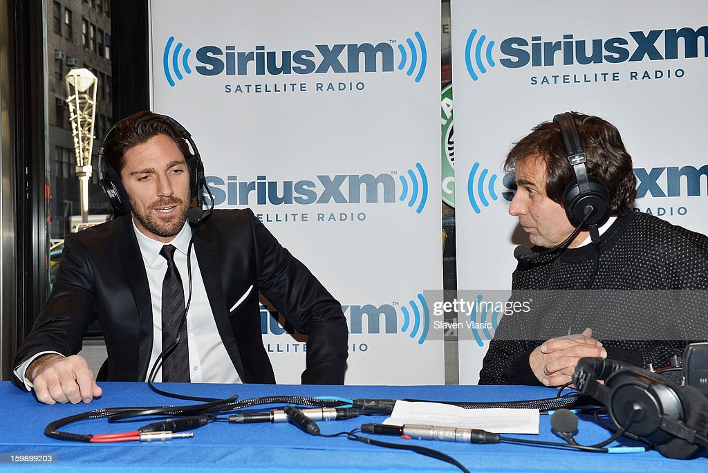 NY Rangers goaltender and reigning Vezina Trophy winner Henrik Lundqvist (L) is interviewed on SiriusXM's 'Mad Dog Unleashed' hosted by Chris 'Mad Dog' Russo (R) at the NHL Powered by Reebok Store on January 22, 2013 in New York City.