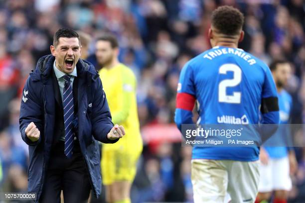 Rangers' Graham Dorrans celebrates victory with James Tavernier after the Ladbrokes Scottish Premiership match at Ibrox Stadium Glasgow