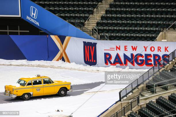 Rangers logo and taxi cab displayed during practice for the the New York Rangers and Buffalo Sabres Winter Classic NHL game on December 31 at Citi...
