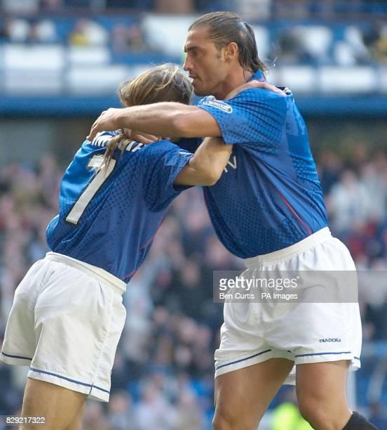 Rangers' Lorenzo Amoruso celebrates scoring against Motherwell with teammate Claudio Caniggia during their Bank of Scotland Scottish Premier League...