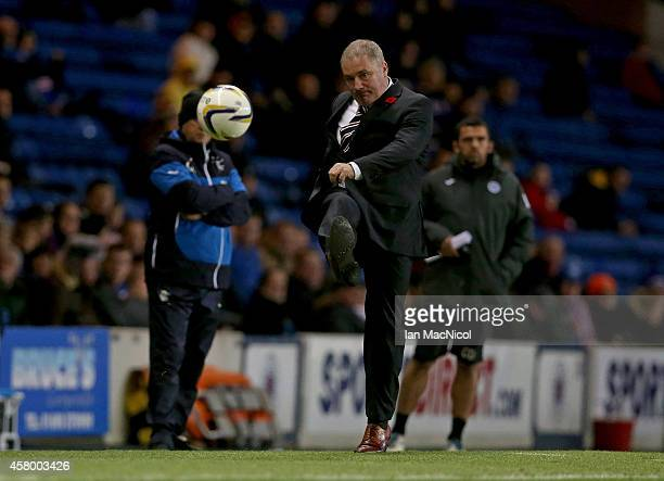 Rangers manager Ally McCoist kicks a ball during the Scottish League Cup Quarter final between Rangers and St Johnstoneat Ibrox Stadium on October 28...