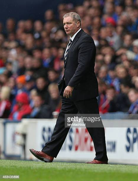 Rangers manager Ally McCoist looks on during the Scottish Championship Opening League Match between Rangers and Hearts at Ibrox Stadium on August 10...