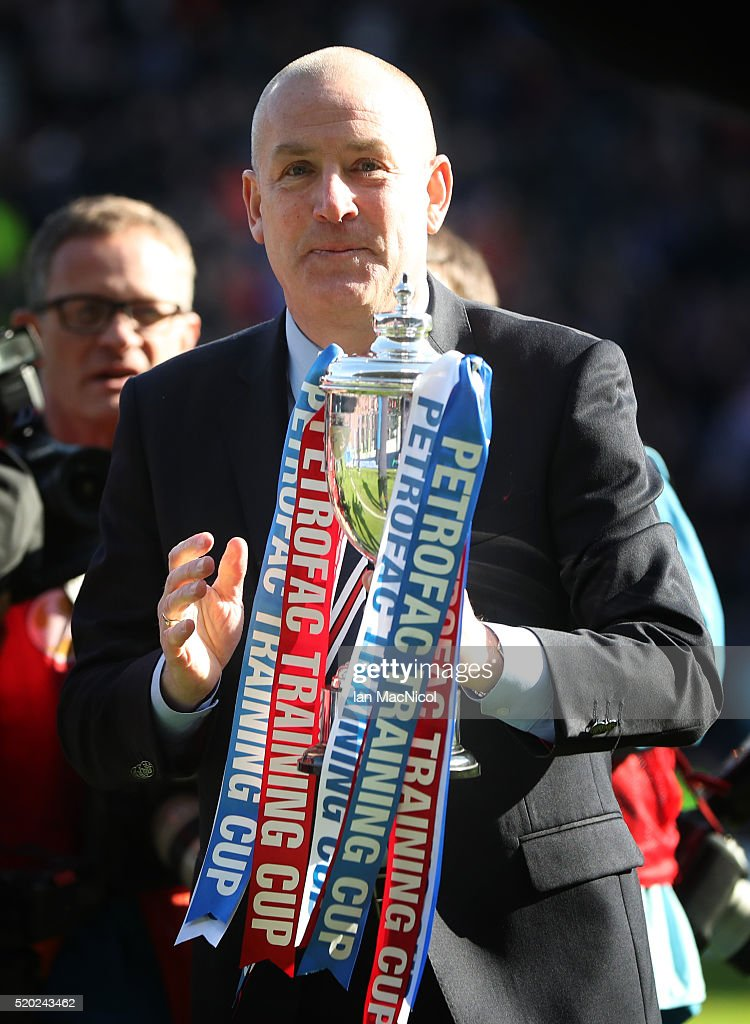 Rangers manager Mark Warburton holds the trophy during the Petrofac Training Cup Final between Rangers and Peterhead at Hampden Park on April 10, 2016 in Glasgow, Scotland.