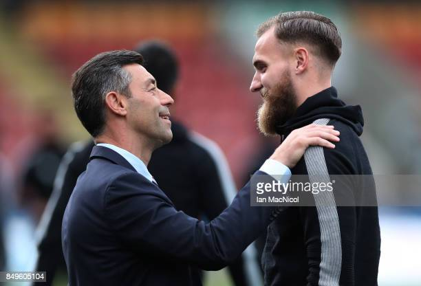 Rangers manager Pedro Caixinha and Jak Alnwick are seen prior to the Betfred League Cup Quarter Final at Firhill Stadium on September 19 2017 in...