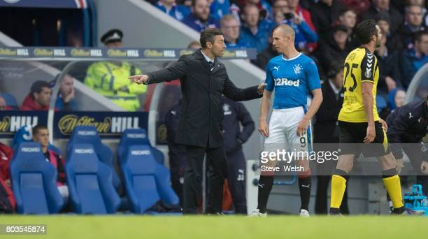 Rangers Manager Pedro Caixinha gives out his instructions to Kenny Miller during the UEFA Europa League first qualifying round match between Rangers...
