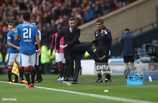 Rangers manager Pedro Caixinha kicks out at a water bottle during the Betfred League Cup Semi Final between Rangers and Motherwell at Hampden Park on...