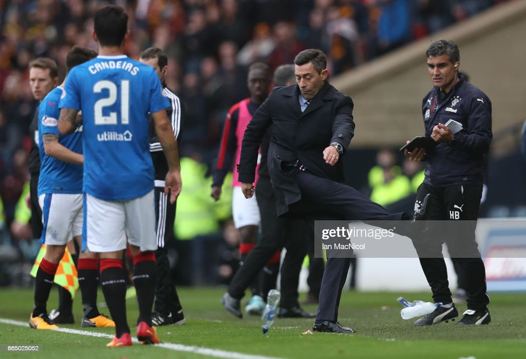 Rangers manager Pedro Caixinha kicks out at a water bottle during the Betfred League Cup Semi Final between Rangers and Motherwell at Hampden Park on October 22, 2017 in Glasgow, Scotland.
