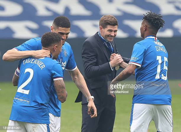 Rangers Manager Steven Gerrard and Bongani Zungu of Rangers are seen during the Scottish Premiership match between Rangers and Aberdeen on May 15,...