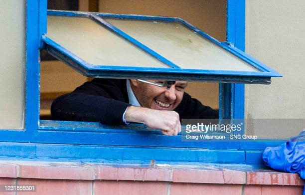 Rangers manager Steven Gerrard celebrates out the window with fans outside during a Scottish Premiership match between Rangers and St Mirren at Ibrox...