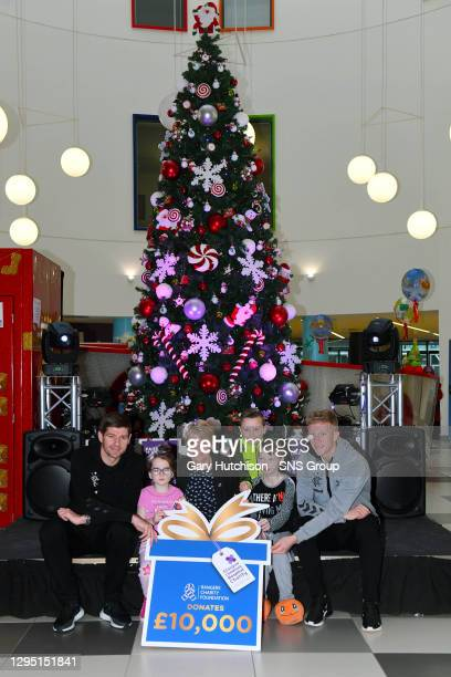 Rangers manager Steven Gerrard, Emily Down , Glasgow Childrens Hospital Chief Executive Shona Cardle, brothers Jack Beer , Robbie Beer and Ross...