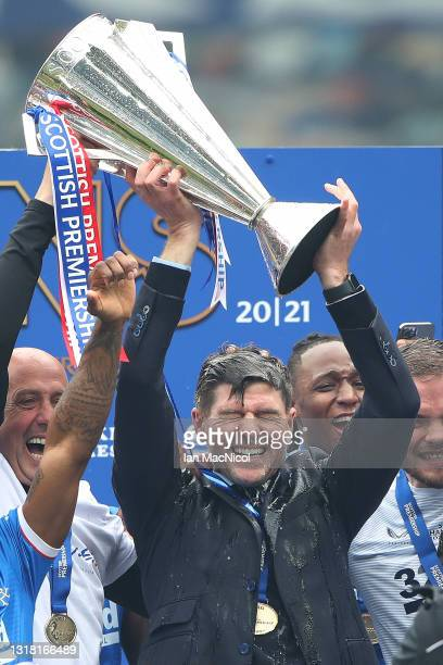 Rangers Manager Steven Gerrard holds the trophy aloft during the Scottish Premiership match between Rangers and Aberdeen on May 15, 2021 in Glasgow,...