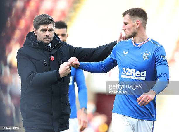Rangers Manager Steven Gerrard is seen with Borna Barisic of Rangers during the Ladbrokes Scottish Premiership match between Motherwell and Rangers...