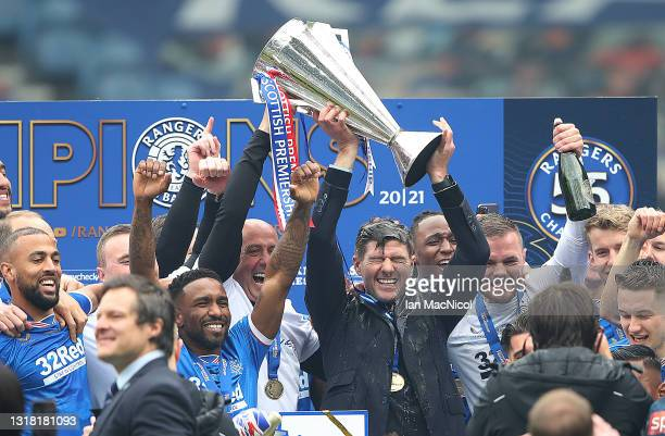 Rangers Manager Steven Gerrard lifts the trophy during the Scottish Premiership match between Rangers and Aberdeen on May 15, 2021 in Glasgow,...