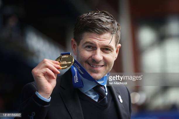 Rangers Manager Steven Gerrard poses with his medal during the Scottish Premiership match between Rangers and Aberdeen on May 15, 2021 in Glasgow,...